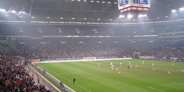 Veltins arena football stadium By Friedrich Petersdorff 600x300 - 11 Famous Football Stadiums: Which is the biggest? The most modern? The most impressive? The strangest?