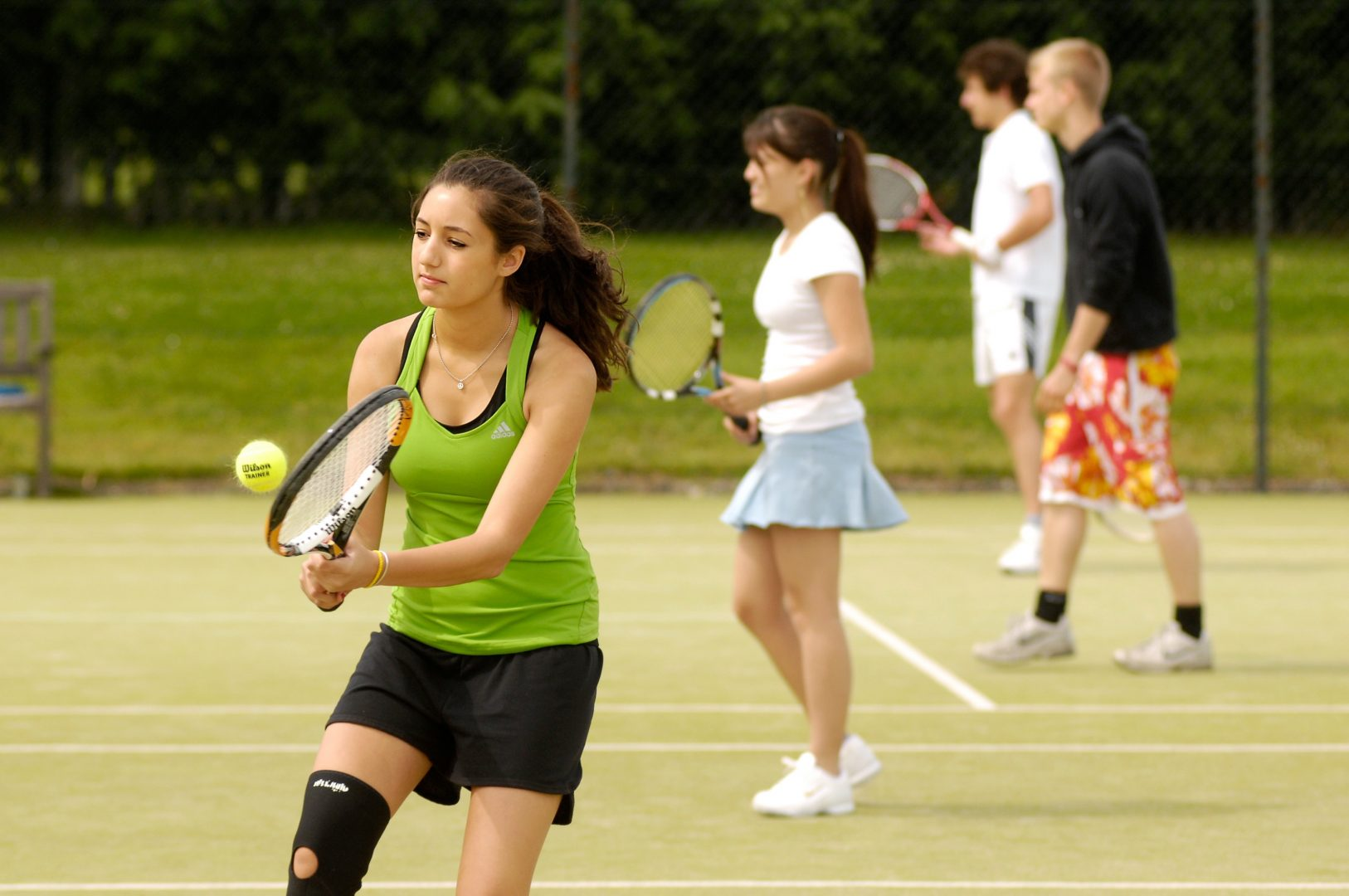 Student of the leadership camp in St. Andrews playing tennis - Leadership camp at university of Cambridge, Yale or ST. Andrews