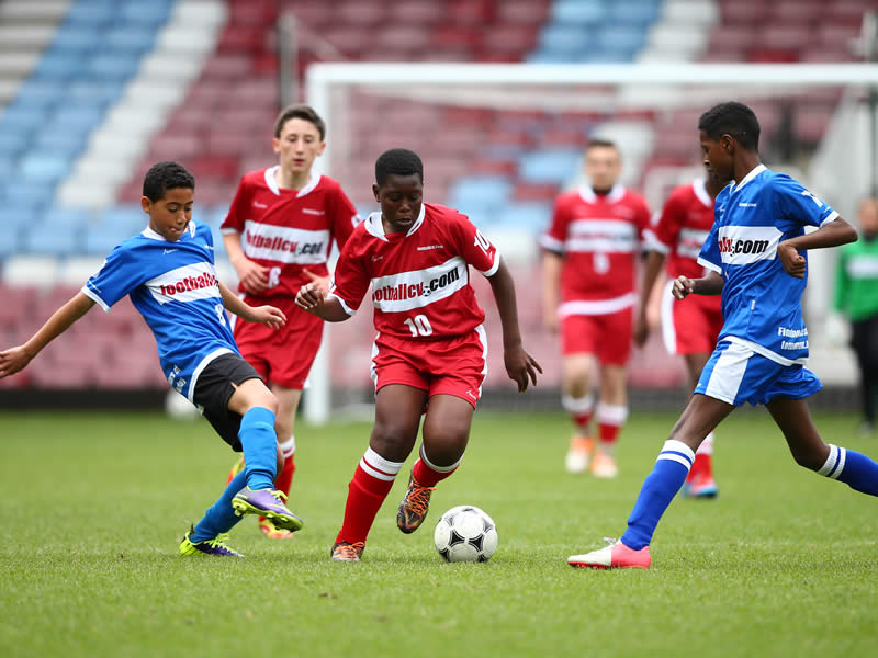Youth soccer players compete - How to get a soccer scholarship to a U.S. university
