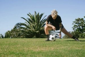 man in black t shirt stretching 3621495 300x200 - Stretching Routine for Youth Athletes. Dynamic vs Stating Stretching